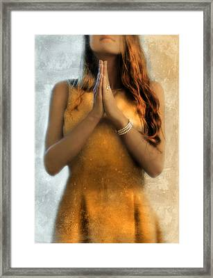 Young Woman Praying Framed Print by Jill Battaglia