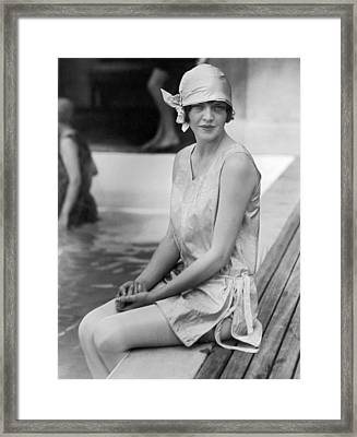 Young Woman Sitting By Pool Framed Print