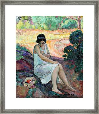 Young Woman Sitting In A Garden Framed Print by Henri Lebasque