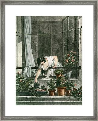 Young Woman Watering Plants Framed Print by Vintage Design Pics