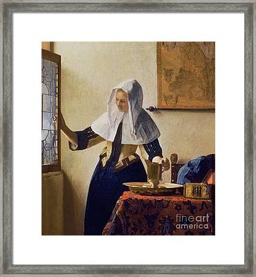 Young Woman With A Water Jug Framed Print by Jan Vermeer