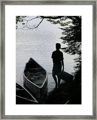 Youth With Canoe Framed Print by Jim DeLillo