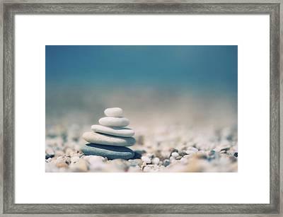 Zen Balanced Pebbles At Beach Framed Print by Alexandre Fundone