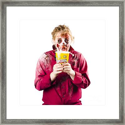 Zombie Woman With Popcorn Framed Print by Jorgo Photography - Wall Art Gallery