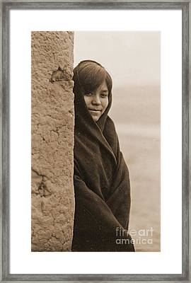 Zuni Girl Smiles Framed Print by Padre Art