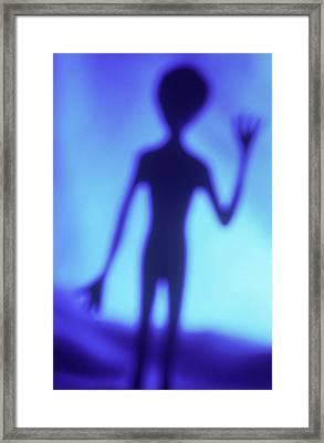 Alien Waving Framed Print by Steven Puetzer