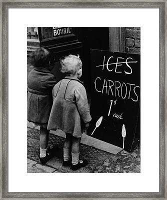 Carrot Lollies Framed Print by Fox Photos
