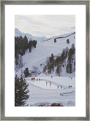Curling At St. Moritz Framed Print by Slim Aarons