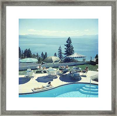Relaxing At Lake Tahoe Framed Print by Slim Aarons
