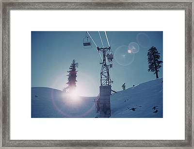 Snowmass Village Framed Print by Slim Aarons
