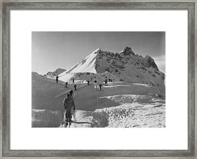 Uphill Skiers Framed Print by Bert Hardy