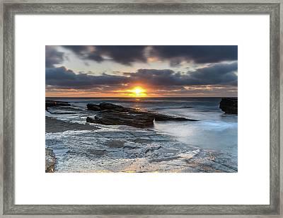 A Moody Sunrise Seascape Framed Print