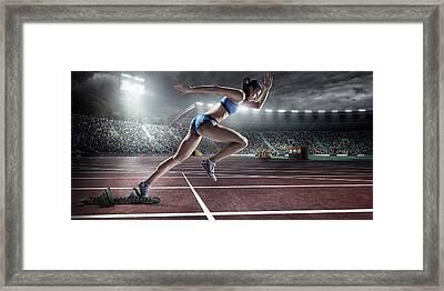 Female Athlete Sprinting Framed Print by Dmytro Aksonov