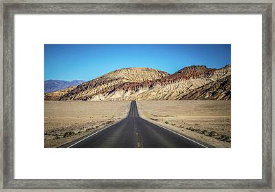 Framed Print featuring the photograph Lonely Road In Death Valley National Park In California by Alex Grichenko