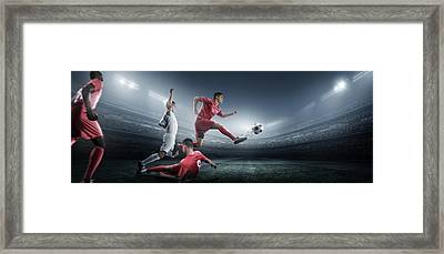 Soccer Player Kicking Ball In Stadium Framed Print by Dmytro Aksonov