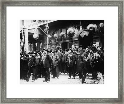 A Crowd Of Men On The Street In Framed Print by Fpg