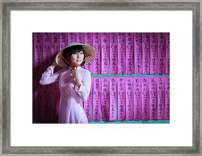 A Girl In A Pink Ao Dai And A Non La Framed Print by Jethuynh