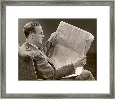 A Man Reads A Newspaper Framed Print by George Marks
