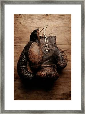 A Pair Of Worn Old Boxing Gloves On Framed Print by The flying dutchman