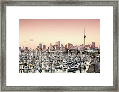 Auckland City And Harbour At Sunset Framed Print by Matteo Colombo