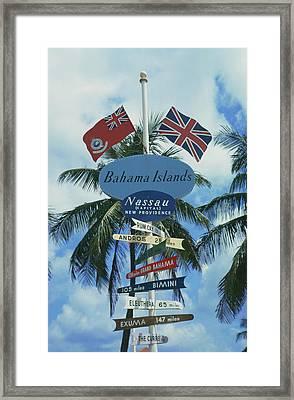 Bahamas Signpost Framed Print by Slim Aarons