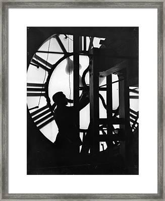 Behind Time Framed Print by Fox Photos