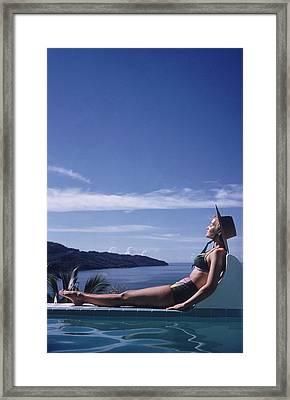 Between Sea And Sky Framed Print by Slim Aarons