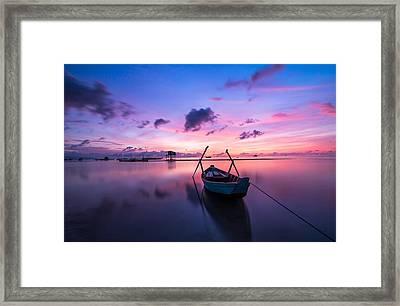 Boat Under The Sunset Framed Print
