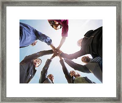 Business People Putting Hands Together Framed Print by John M Lund Photography Inc