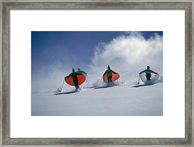 Caped Skiers Framed Print by Slim Aarons