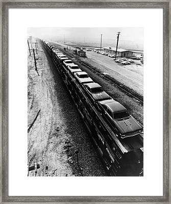 Car Train Framed Print by Fox Photos
