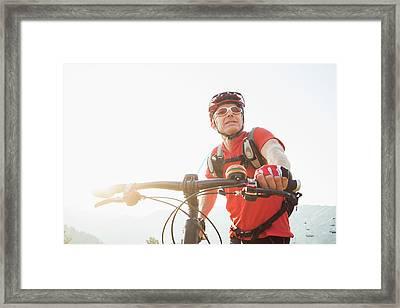 Caucasian Man Pushing Mountain Bike Framed Print by Mike Kemp