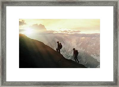Climbers On A Mountain Ridge Framed Print by Buena Vista Images