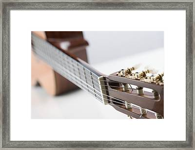 Close-up Of A Guitar Framed Print by Jamie Grill
