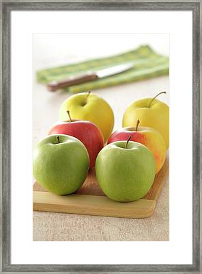 Close-up Of Apples On Cutting Board Framed Print