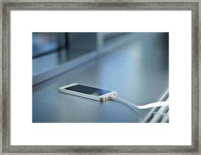 Close-up Of Smartphone Charging Framed Print by Klaus Vedfelt