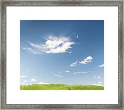 Clouds Over Green Hills Framed Print by Adrian Studer