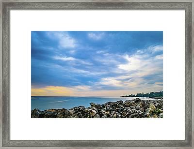 Cloudy City Coastline Framed Print