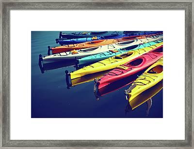 Colorful Kayaks Framed Print by Kyle Igarashi