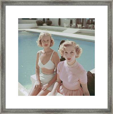 Connelly And Guest Framed Print by Slim Aarons