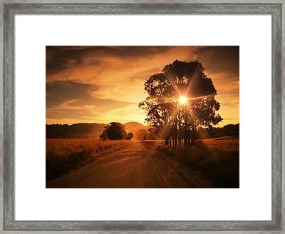 Country Road Against Cloudy Sky At Framed Print by Glenn Homann / Eyeem