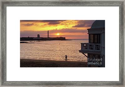 Framed Print featuring the photograph Couple At Sunset In La Caleta Cadiz Spain by Pablo Avanzini