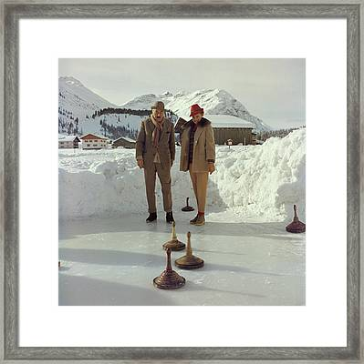 Curling Framed Print by Slim Aarons
