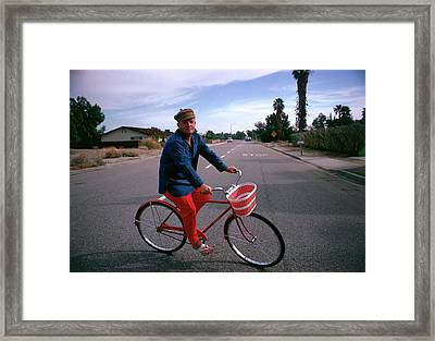 Cycling Capote Framed Print by Slim Aarons