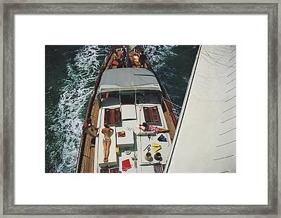 Deck Dwellers Framed Print by Slim Aarons
