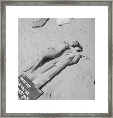 Diana Dors Lying On The Beach At Cannes Framed Print
