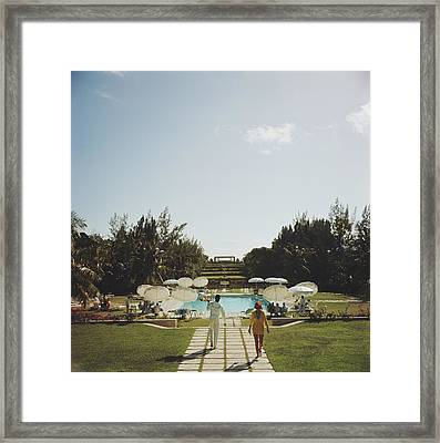Dining In The Bahamas Framed Print by Slim Aarons