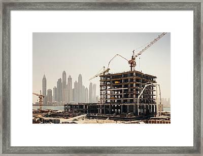 Dubai Construction Framed Print by Borchee