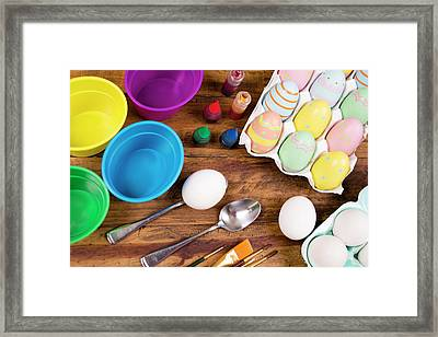 Easter Eggs Being Decorated On Wooden Framed Print by Fstop123