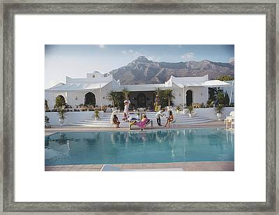 El Venero Framed Print by Slim Aarons